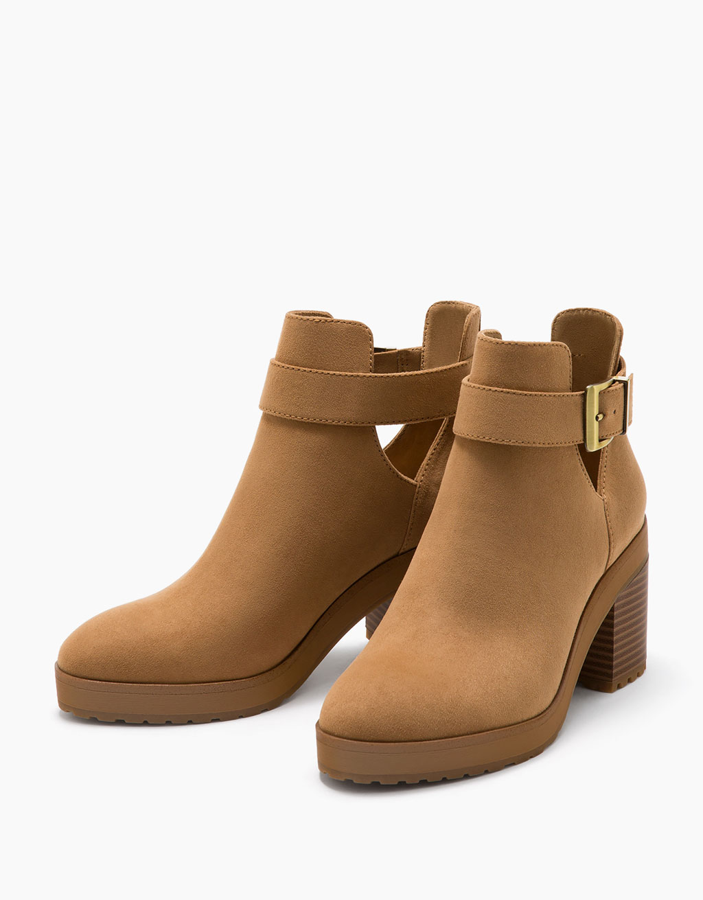 Mid heel ankle boots with openings and buckle